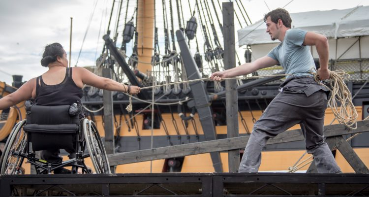 Live outdoors performance of The Seafarers. Two dancers, joined by a rope they hold and suspend between them