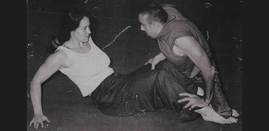 A black and white photo of Vicki and Dave dancing together on the floor.