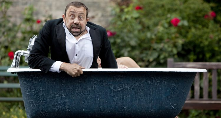 Dave and Lucy in a bathtub during an outdoor performance of Bill and Bobby.