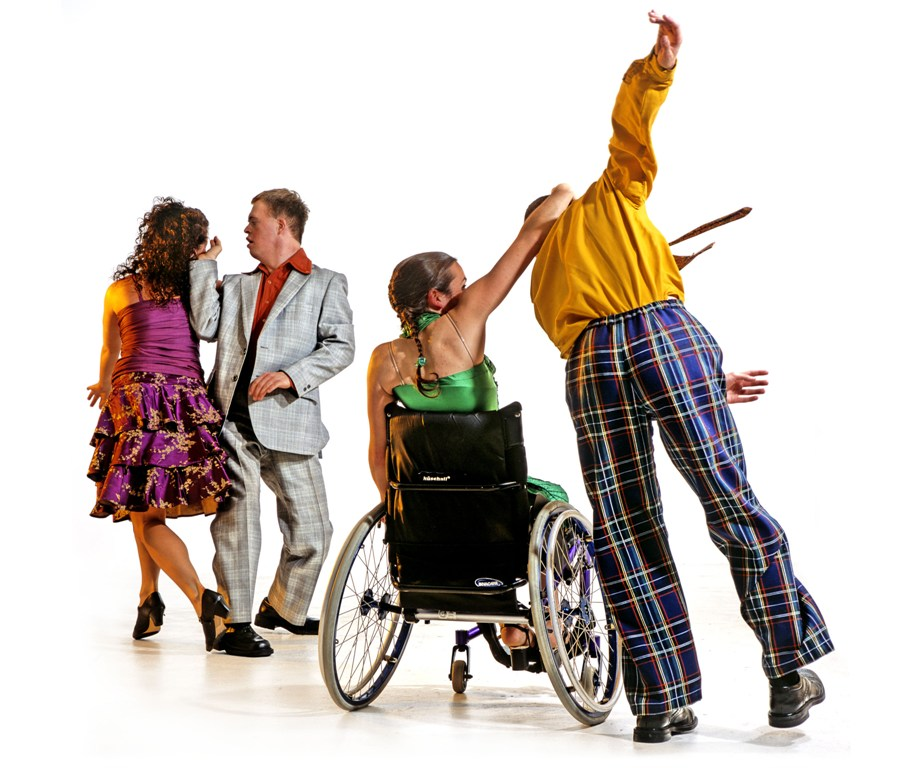 A photo from Corpus (2004), showing a group of three standing dancers and one wheelchair dancer.