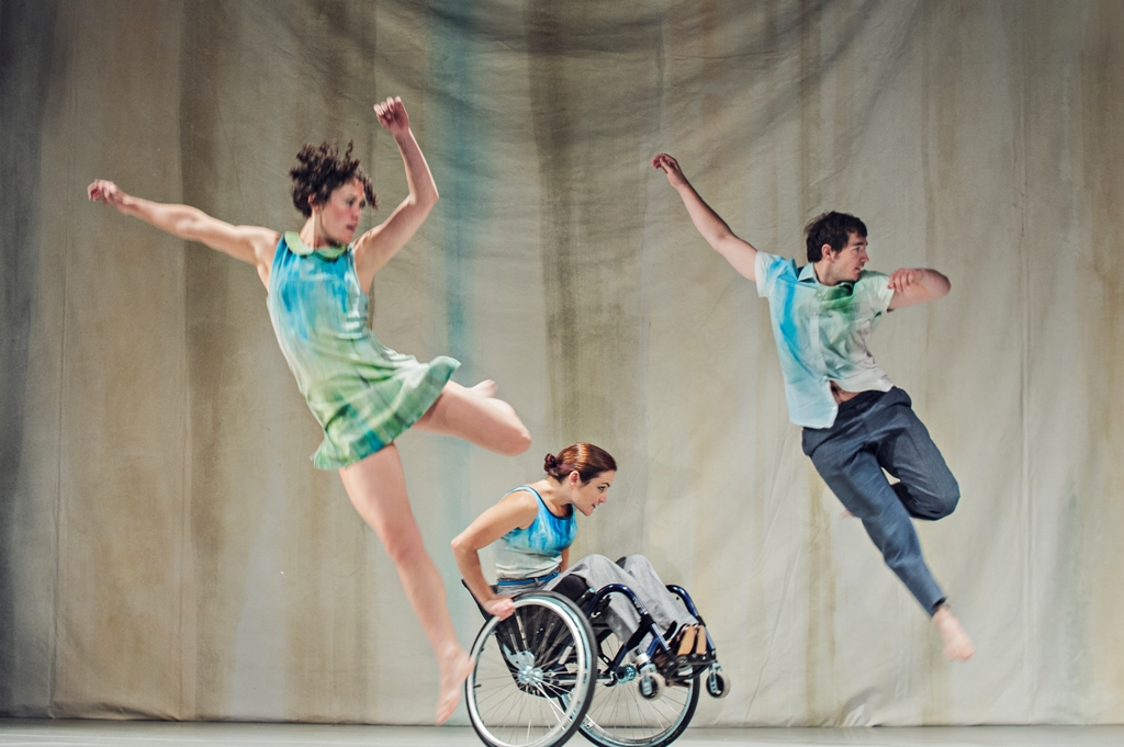 A photo from Artificial Things (2014) with two standing and one wheelchair dancer.