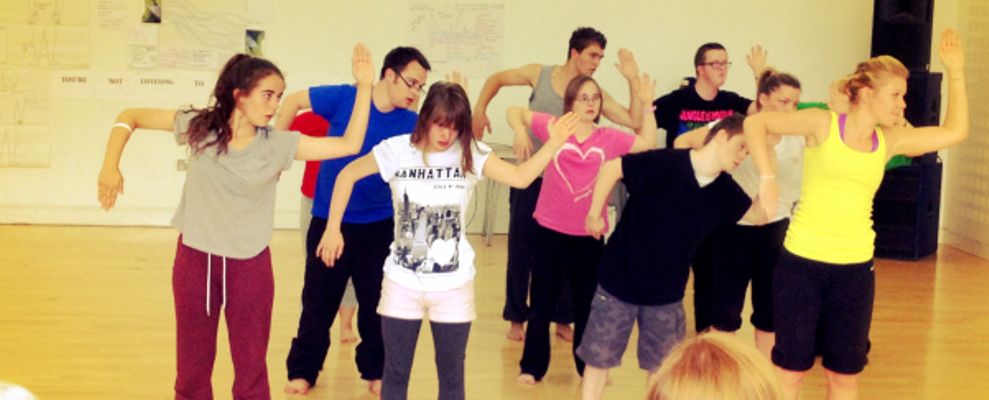 Members of a youth dance group dancing in the studio.