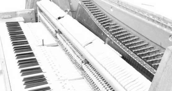 Black and white photo of a piano