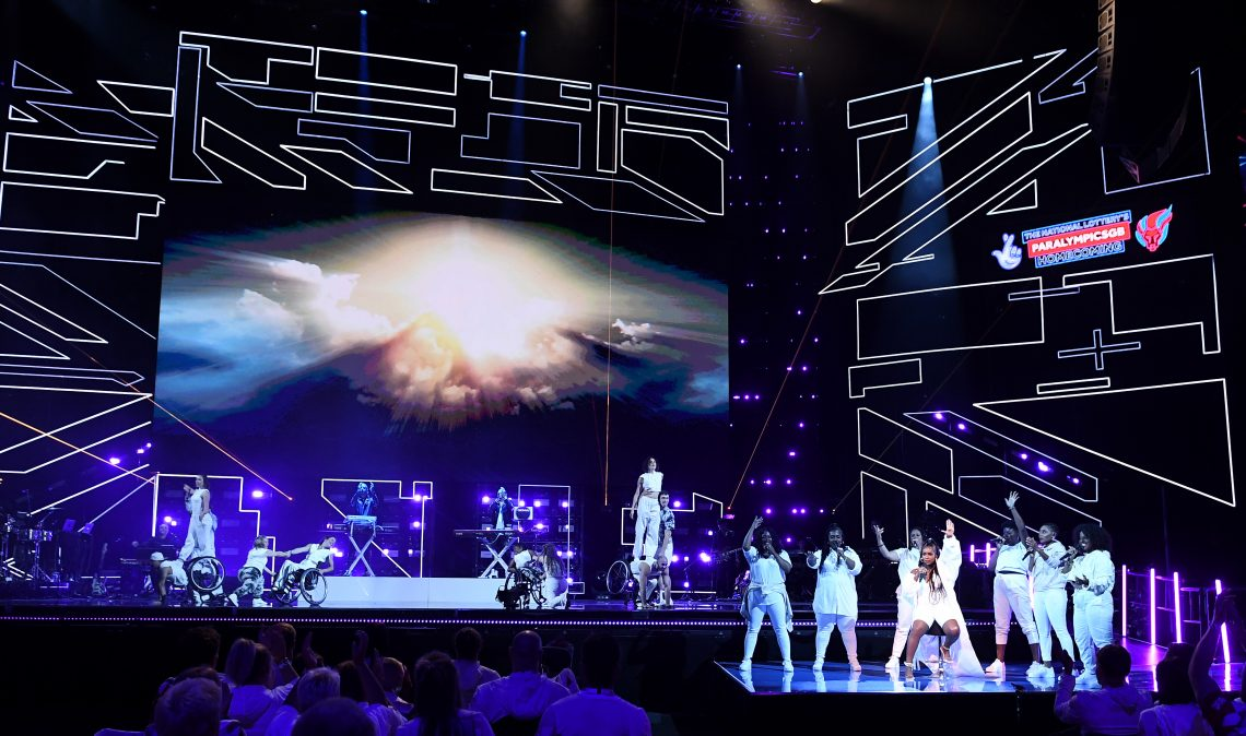 Carla Marie and her six backing vocalists are standing on a small platform at the front of the stage to the right, with the dancers on the main stage at the back. the two DJ of Sigma are on a raised platform at the back behind their DJ kit.